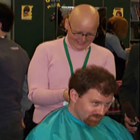 Tony George getting shaved for Bald for Bucks in honor of sister