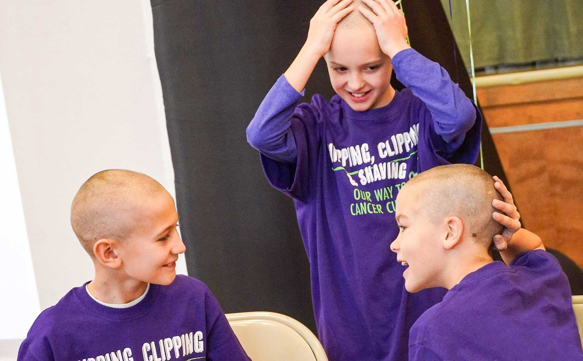 3 students with shaved heads