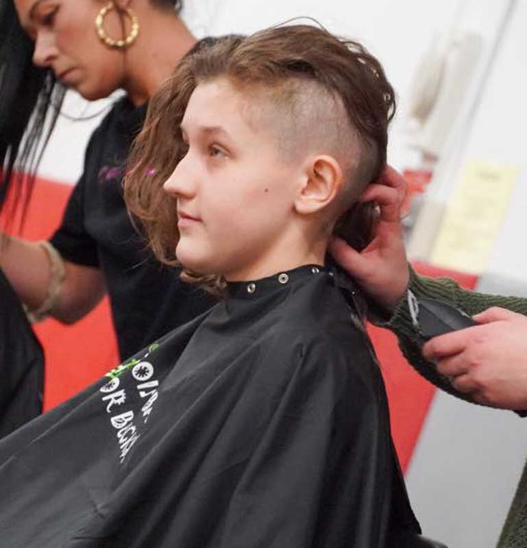 Student going Bald for Bucks with half shaved head